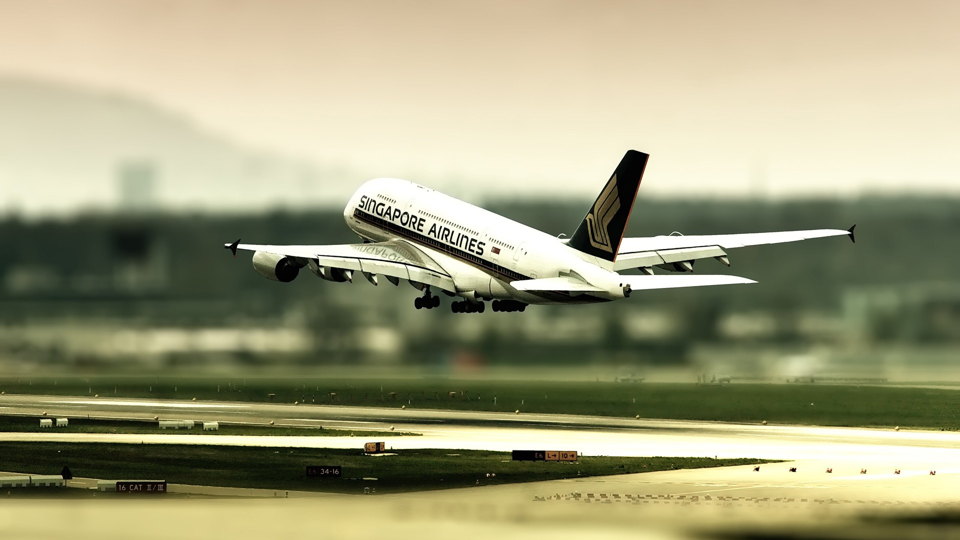 Singapore Airlines, the photo of a commercial aircraft on takeoff.