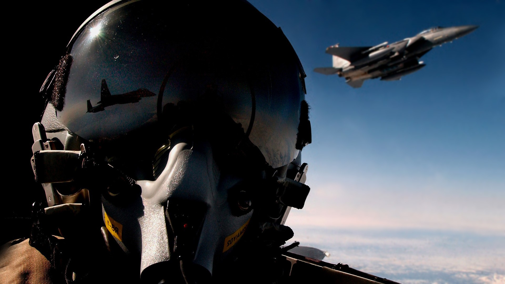 The military pilot in a helmet at work, photo wallpaper