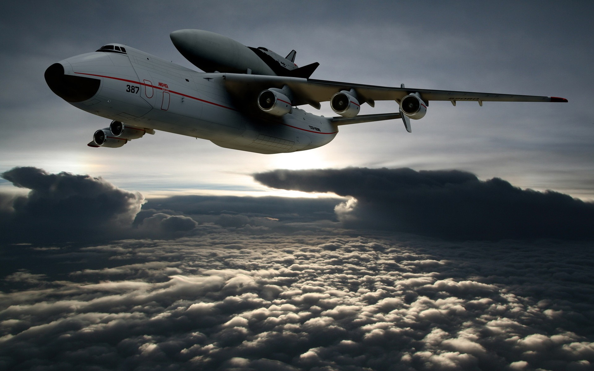 The space shuttle docked to the cargo plane flying above the clouds