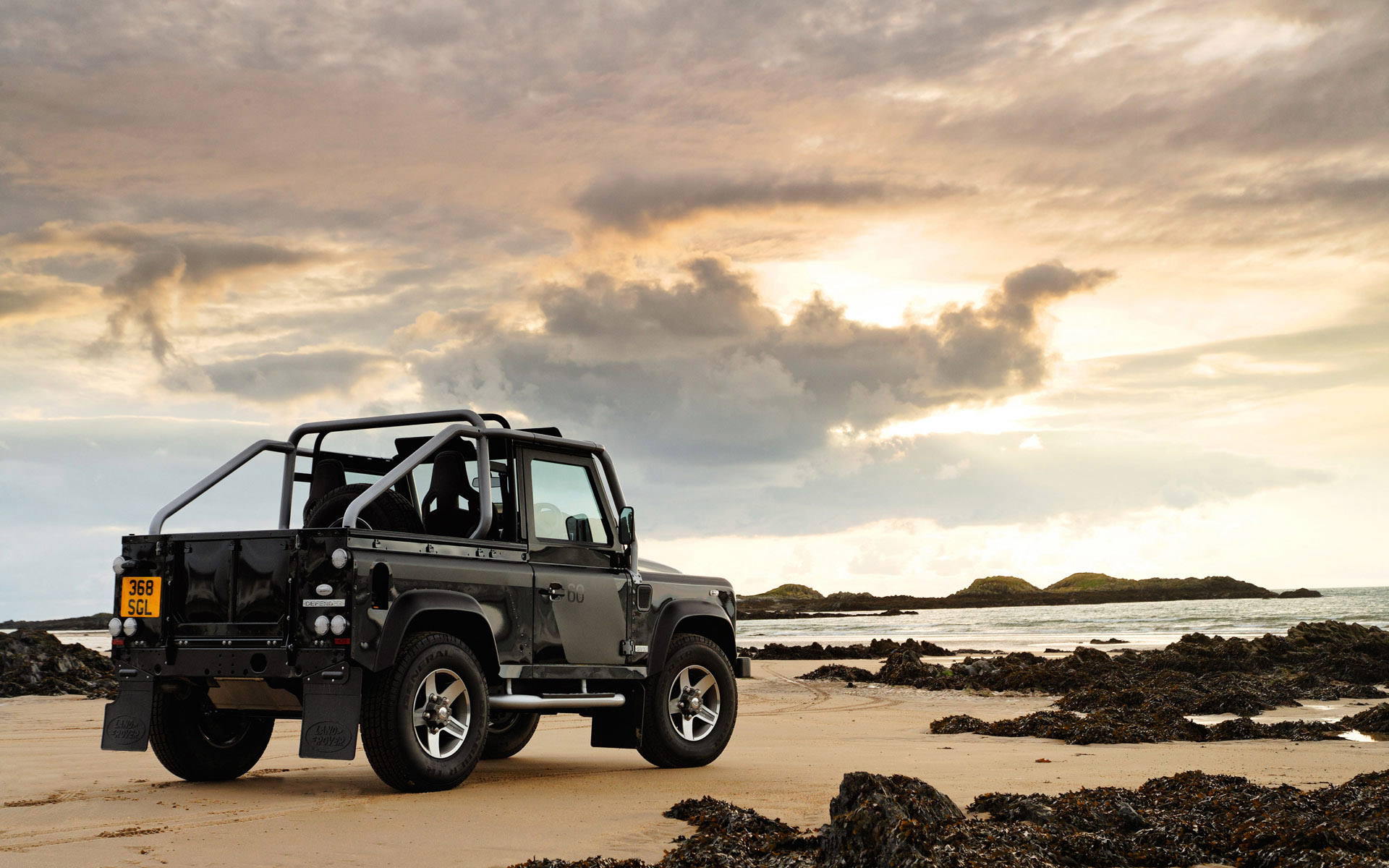 Black Land Rover Defender, the photo on the coast