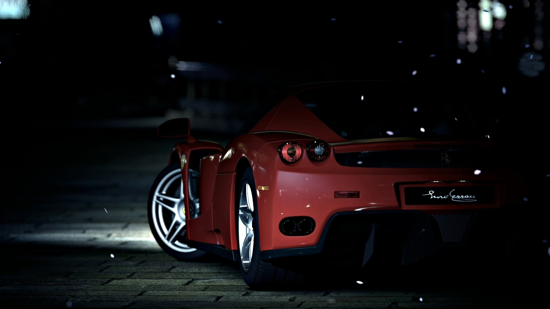Red Ferrari in the night, rear view