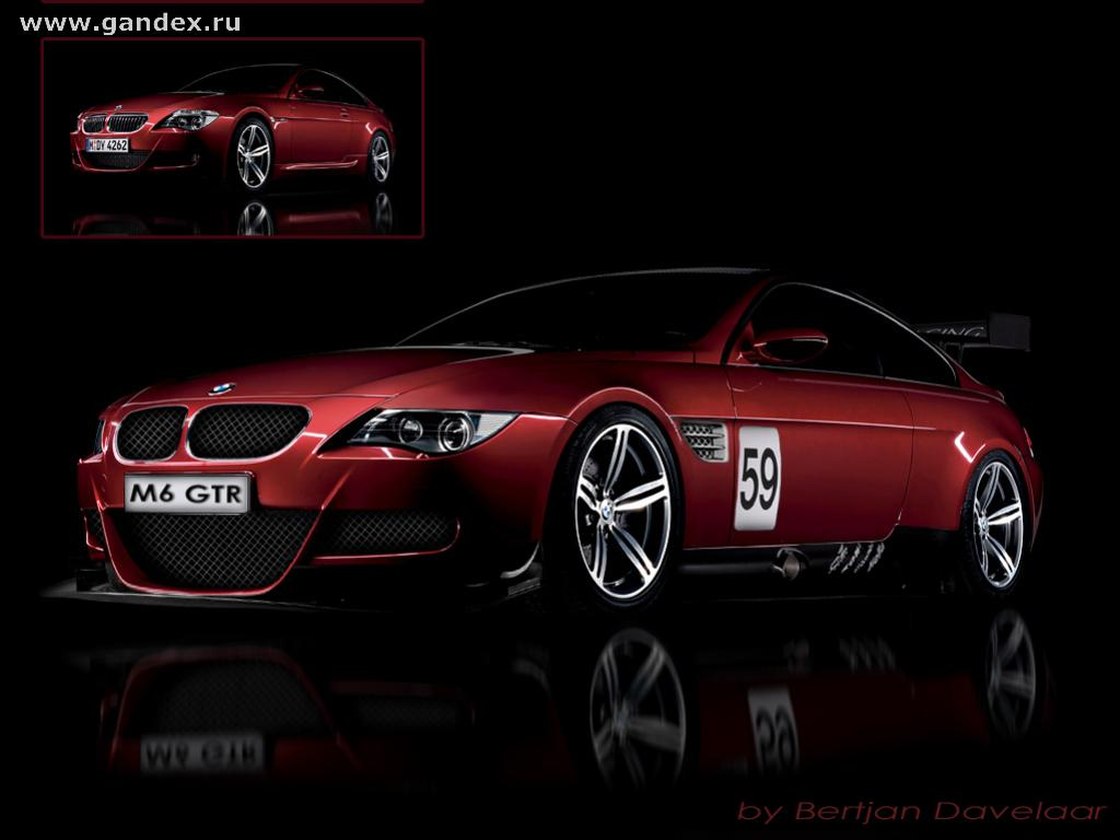 Sporty, red BMW car on a black background for your desktop