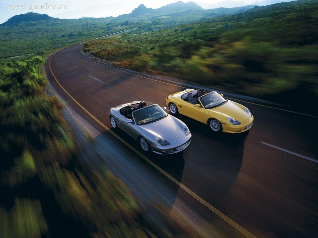 Two car Porshe in motion on a suburban road - the background on your desktop