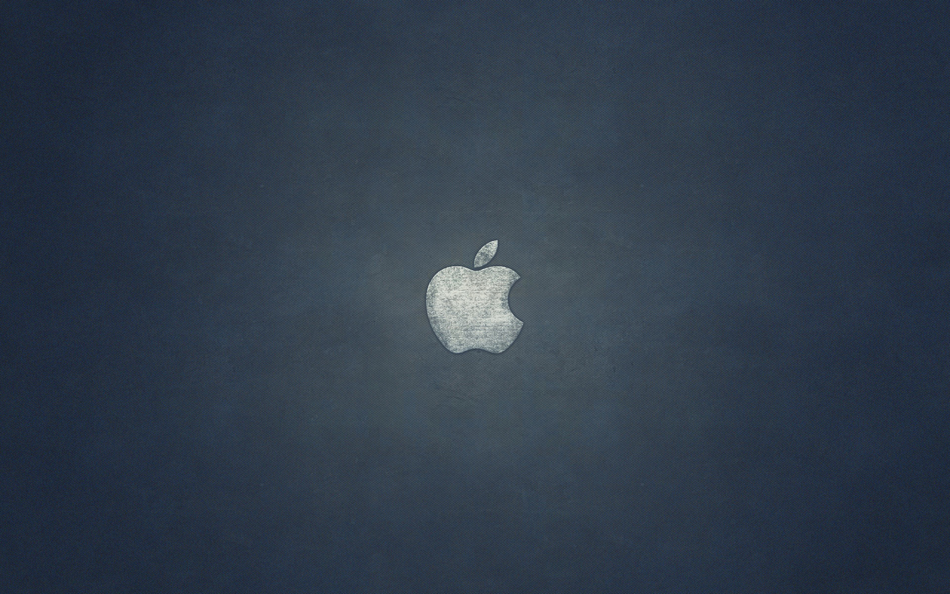 The Apple logo on the jeans texture.
