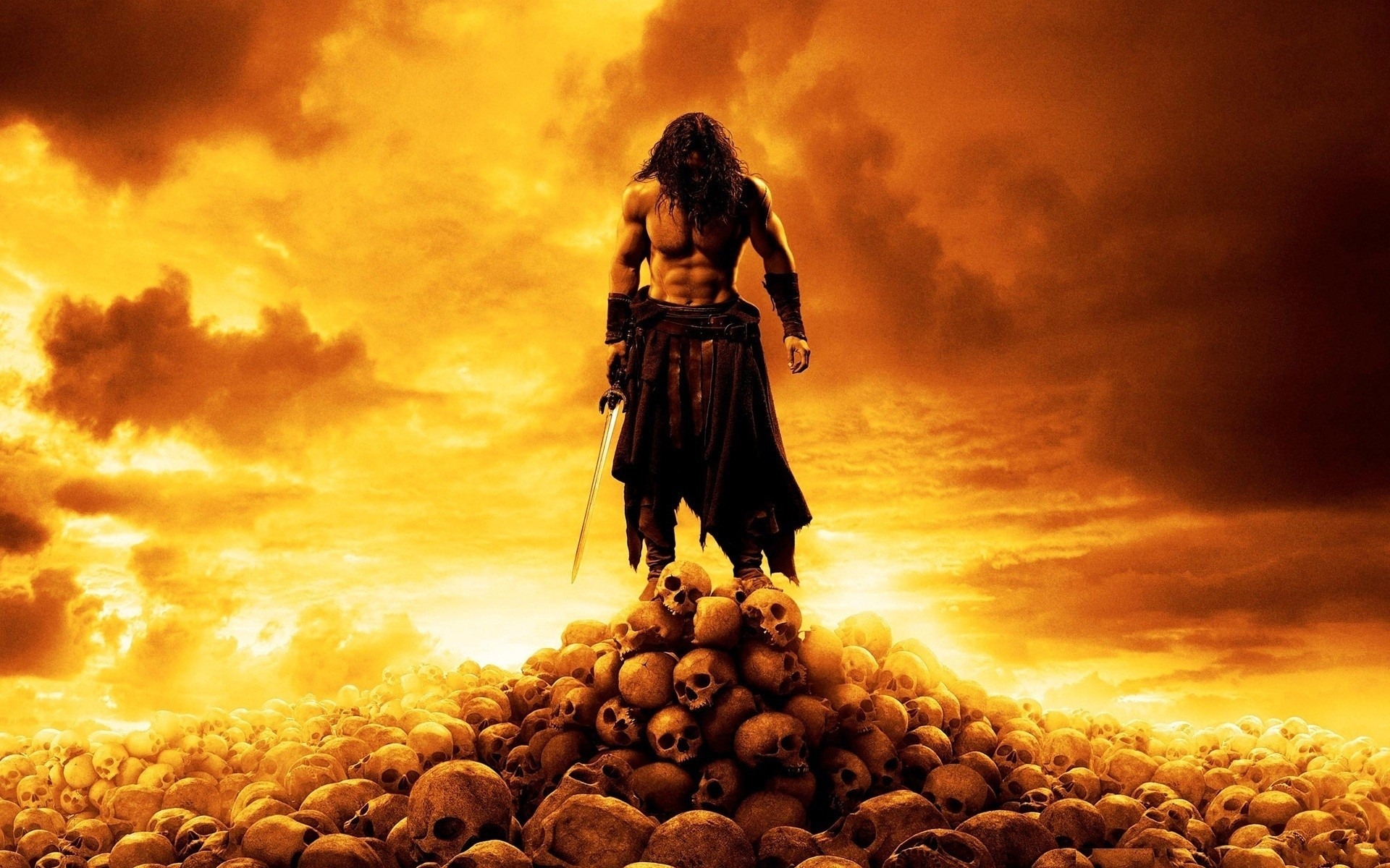 A warrior with a sword on a mountain of human skulls