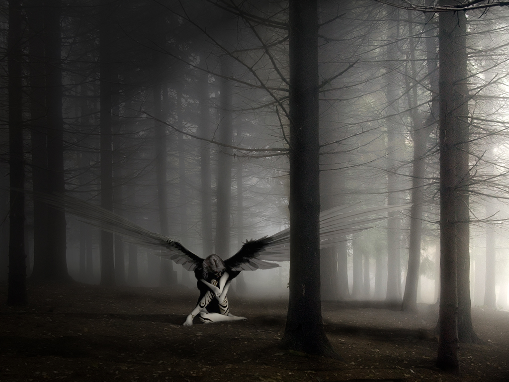 Upset angel in the forest