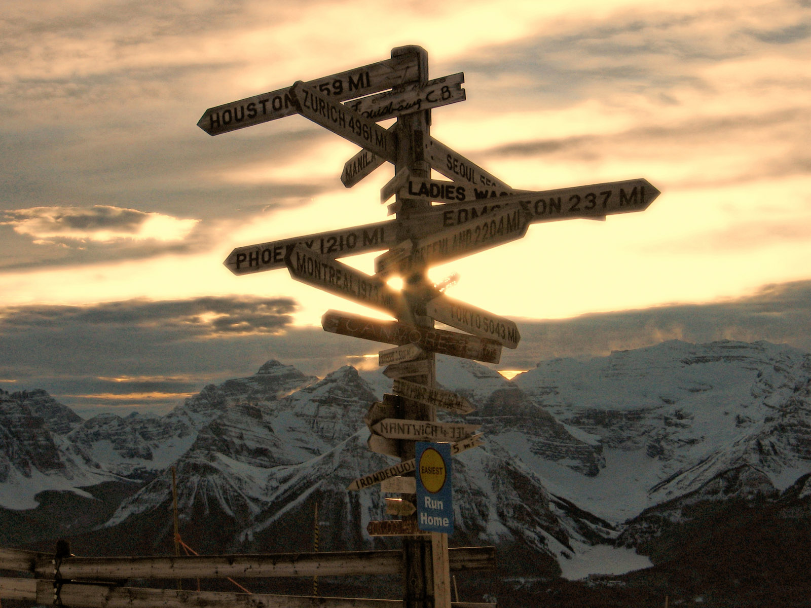 A crossroads in the mountains, signs, road, mountain - background for your desktop