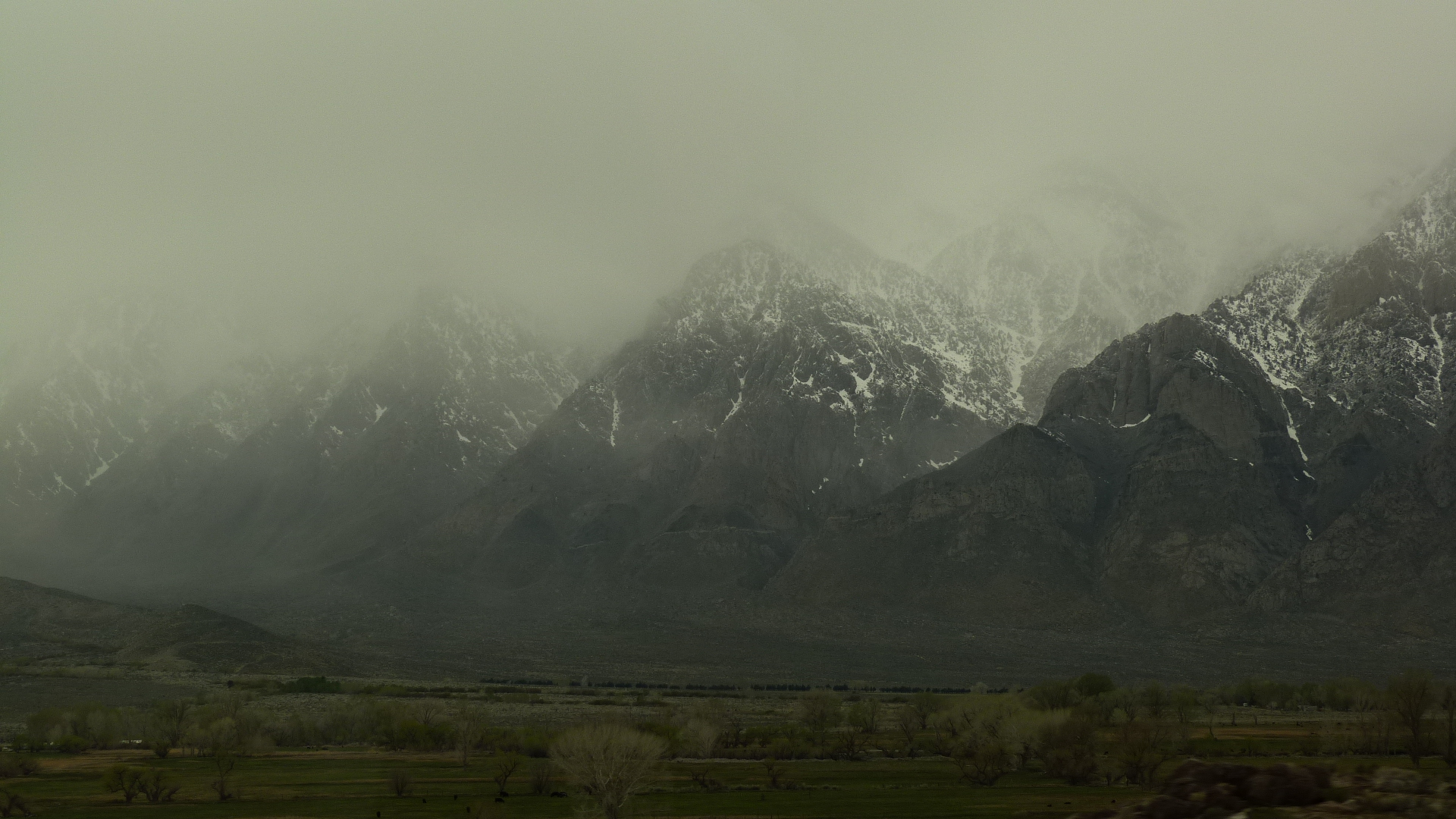 Snow-covered mountains in clouds or fog