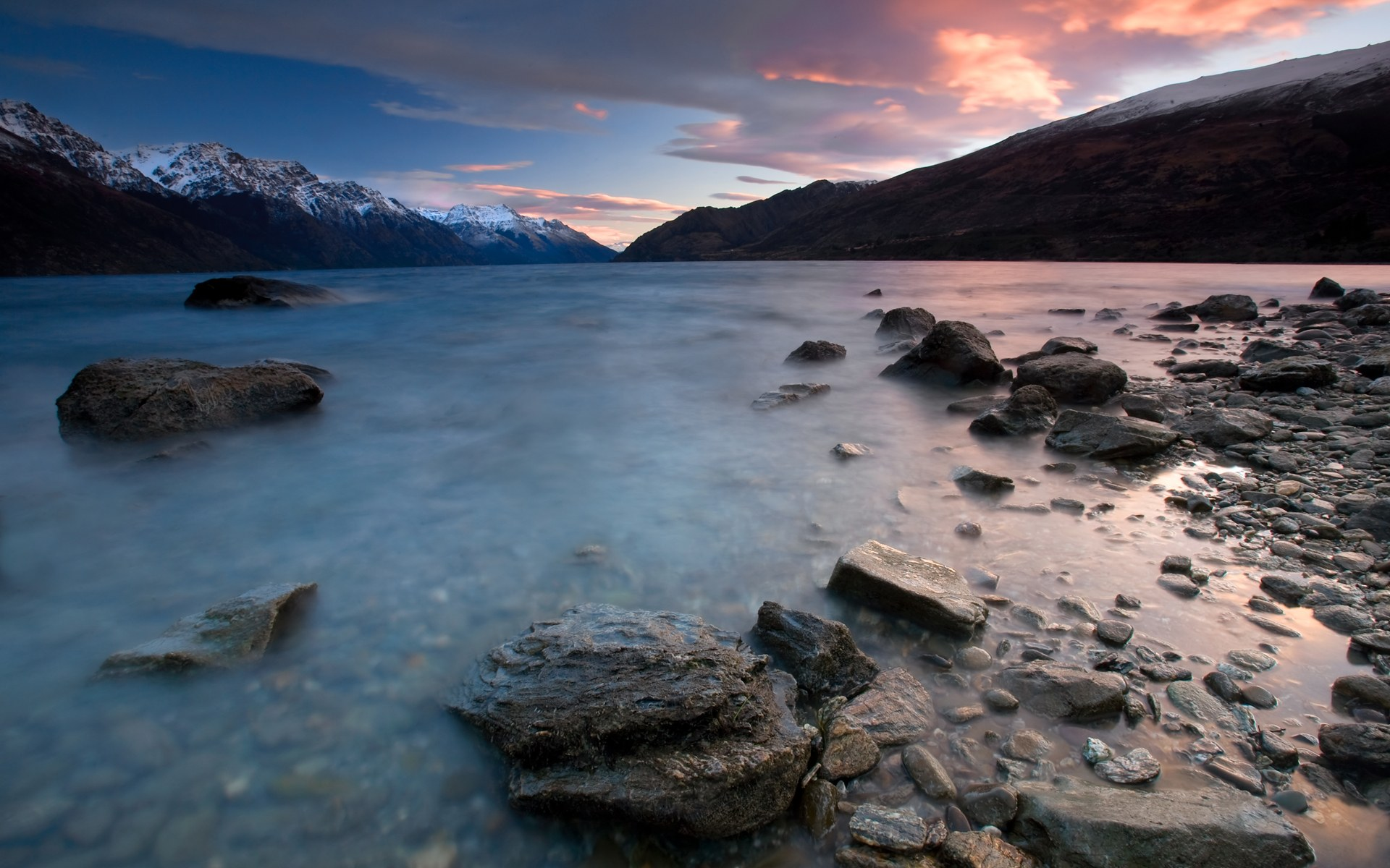 Sunrise in New Zealand over a mountain lake