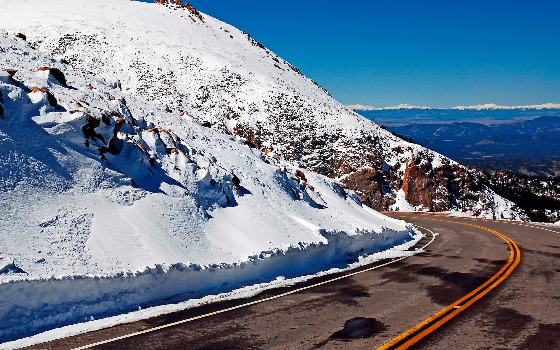 The road in the snowy mountains
