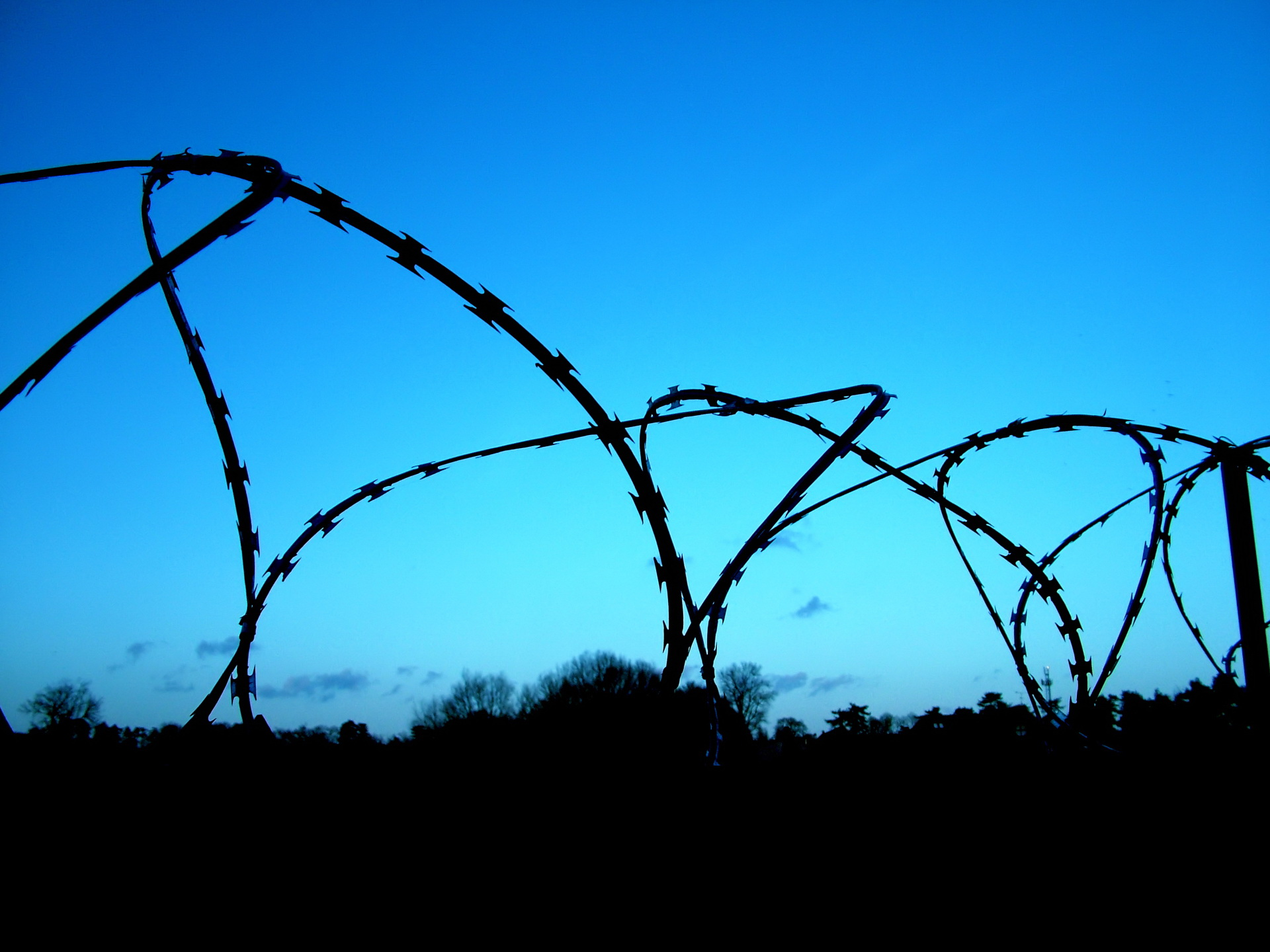 Barbed wire and blue sky wallpaper