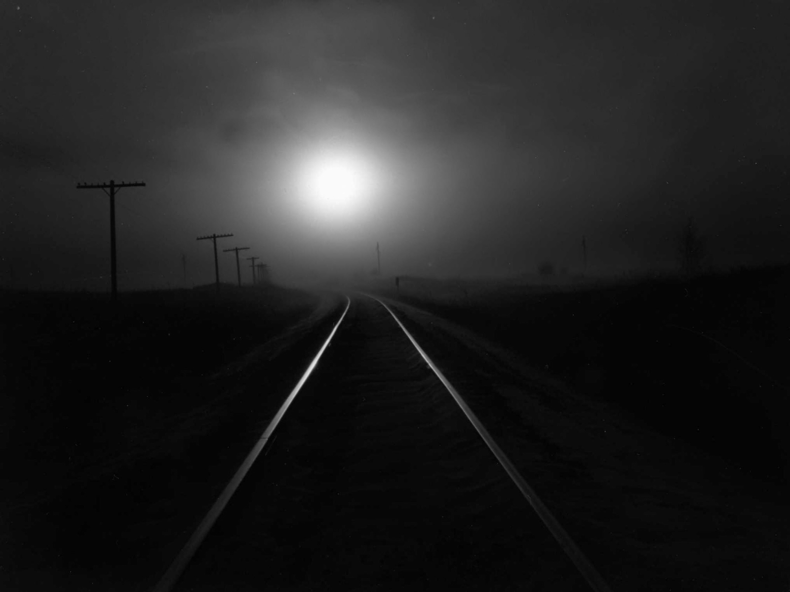 black and white photo of a railroad