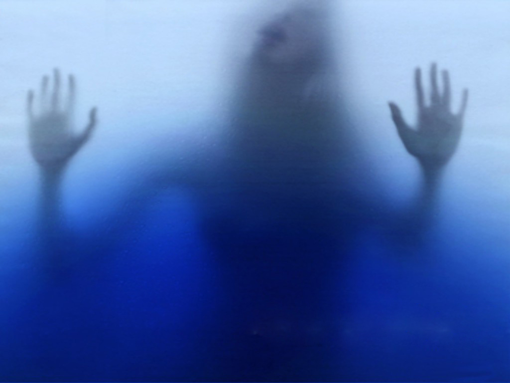 girl in a shower of blue frosted glass
