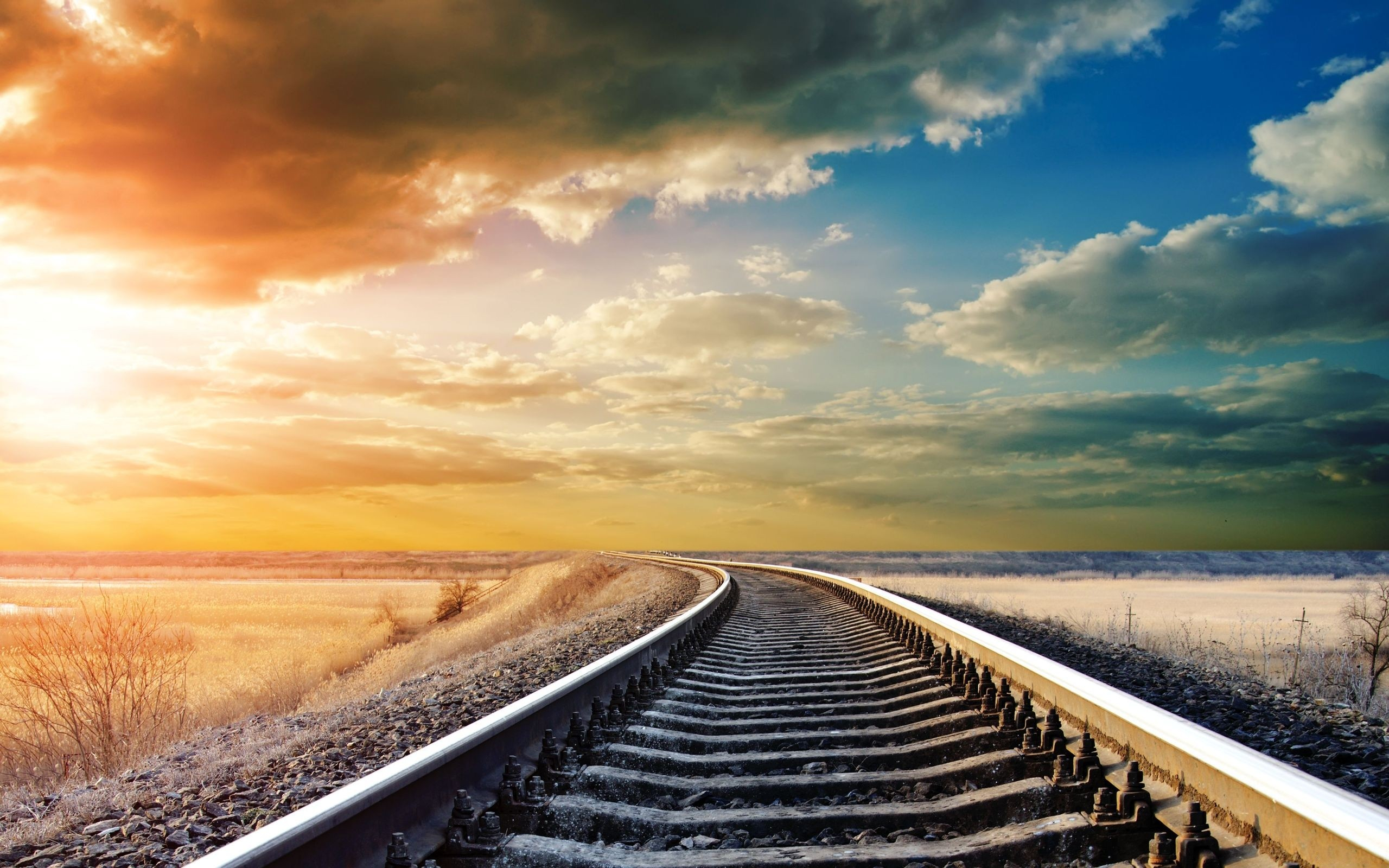 The railway stretches into the distance, a beautiful sunset.