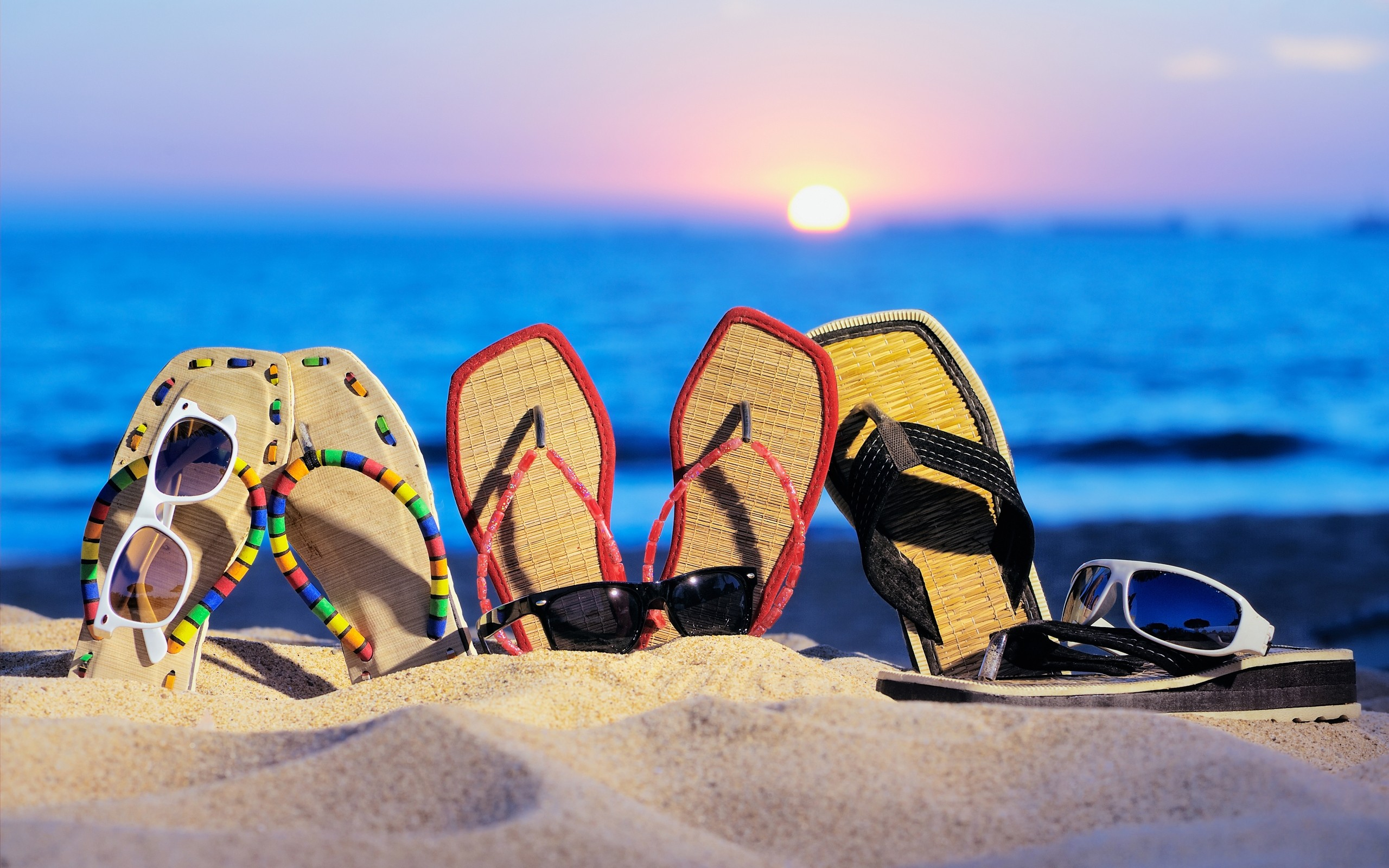 Flip-flops and sunglasses on the beach