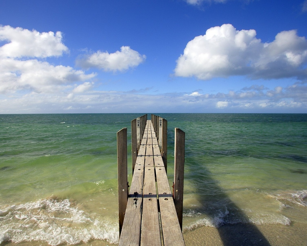 Old wooden pier and the sea coast.
