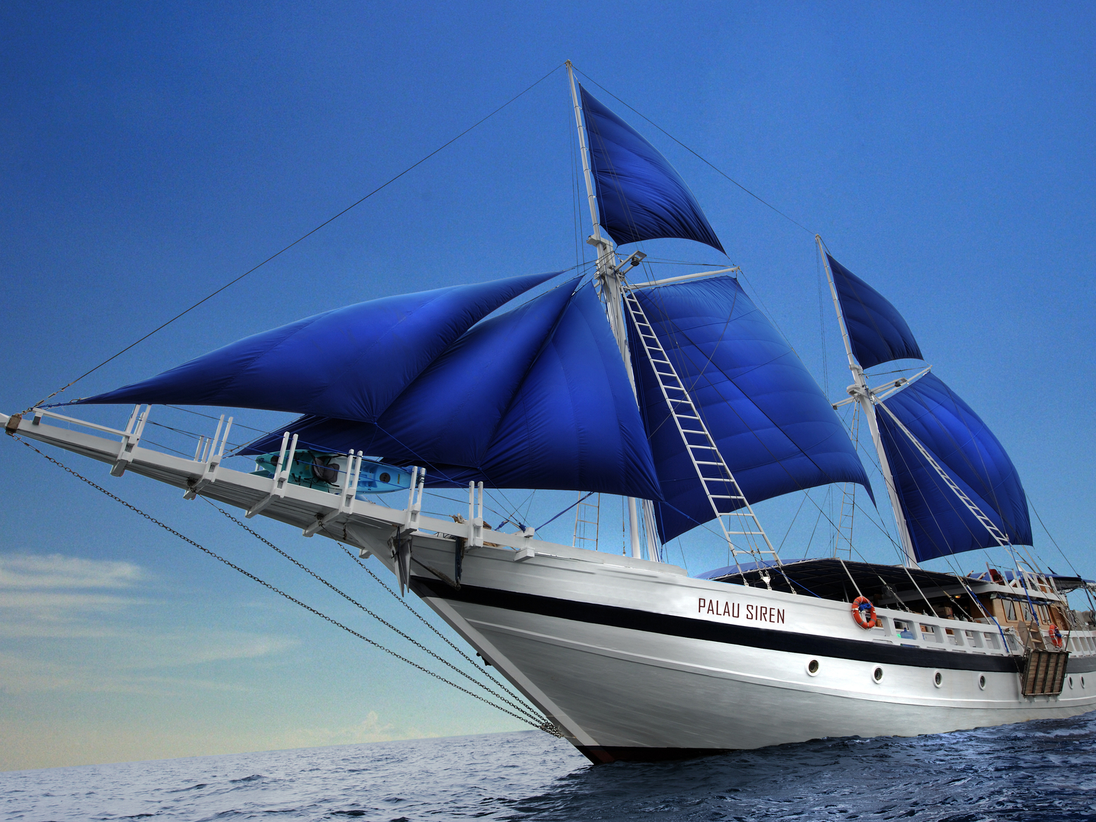Yacht with blue sails
