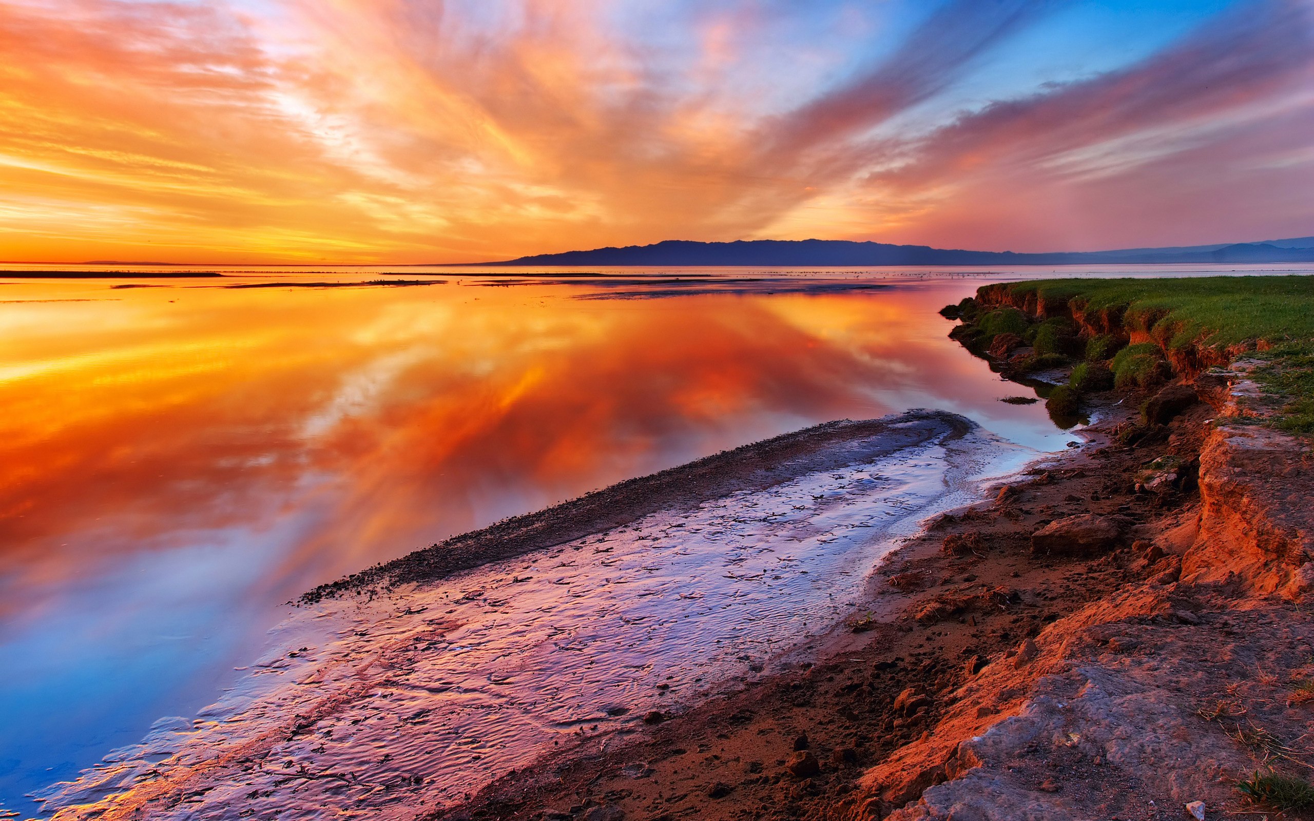 Sunset over the quiet surface of water