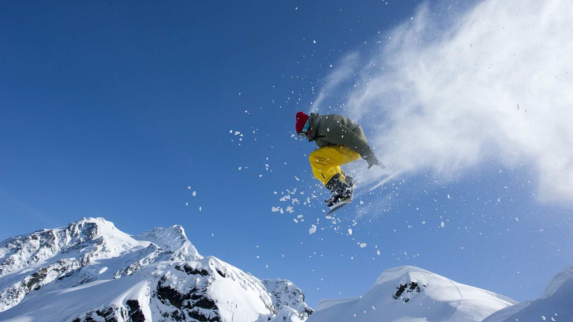 Cool jump on a snowboard in the mountains