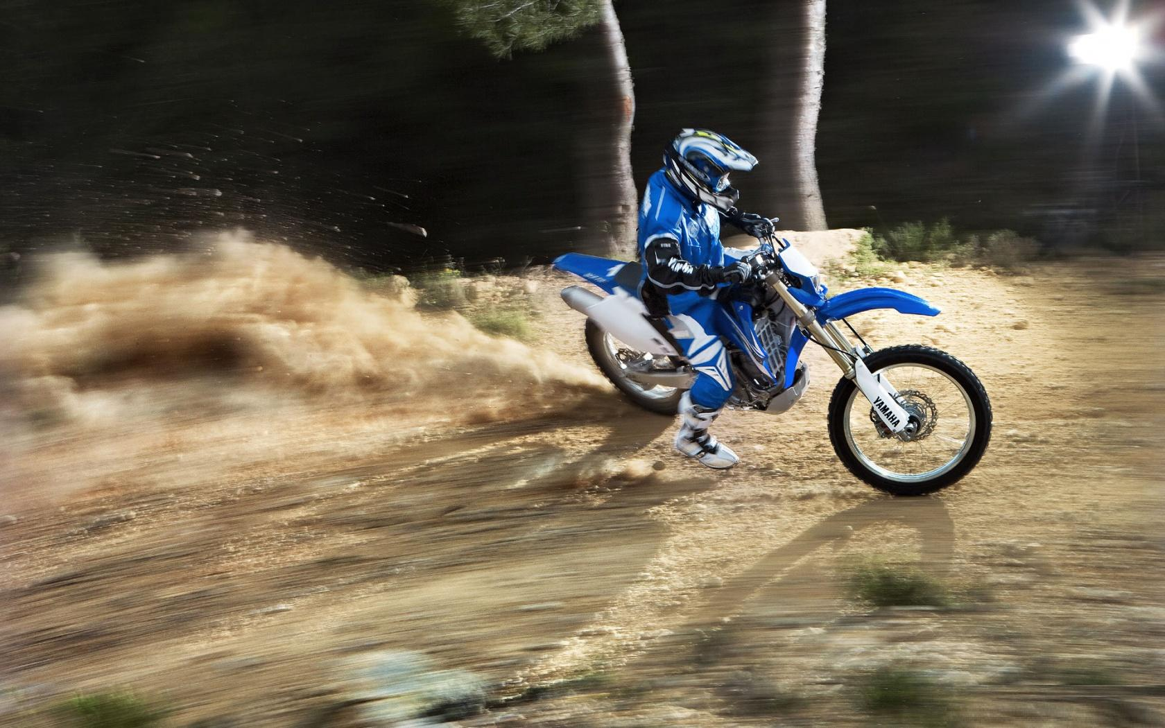 Mountain motorcycle trial, sportsman on a motorcycle Yamaha