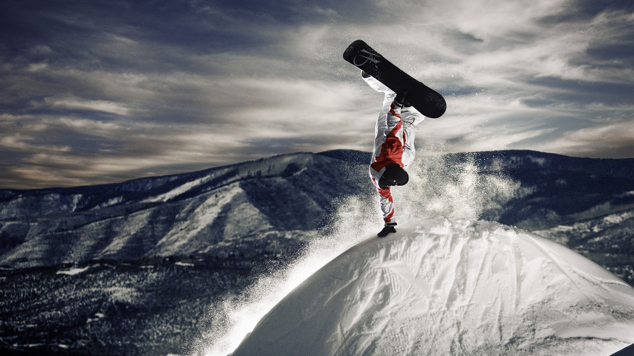 Snowboarder - stunt on top of a mountain