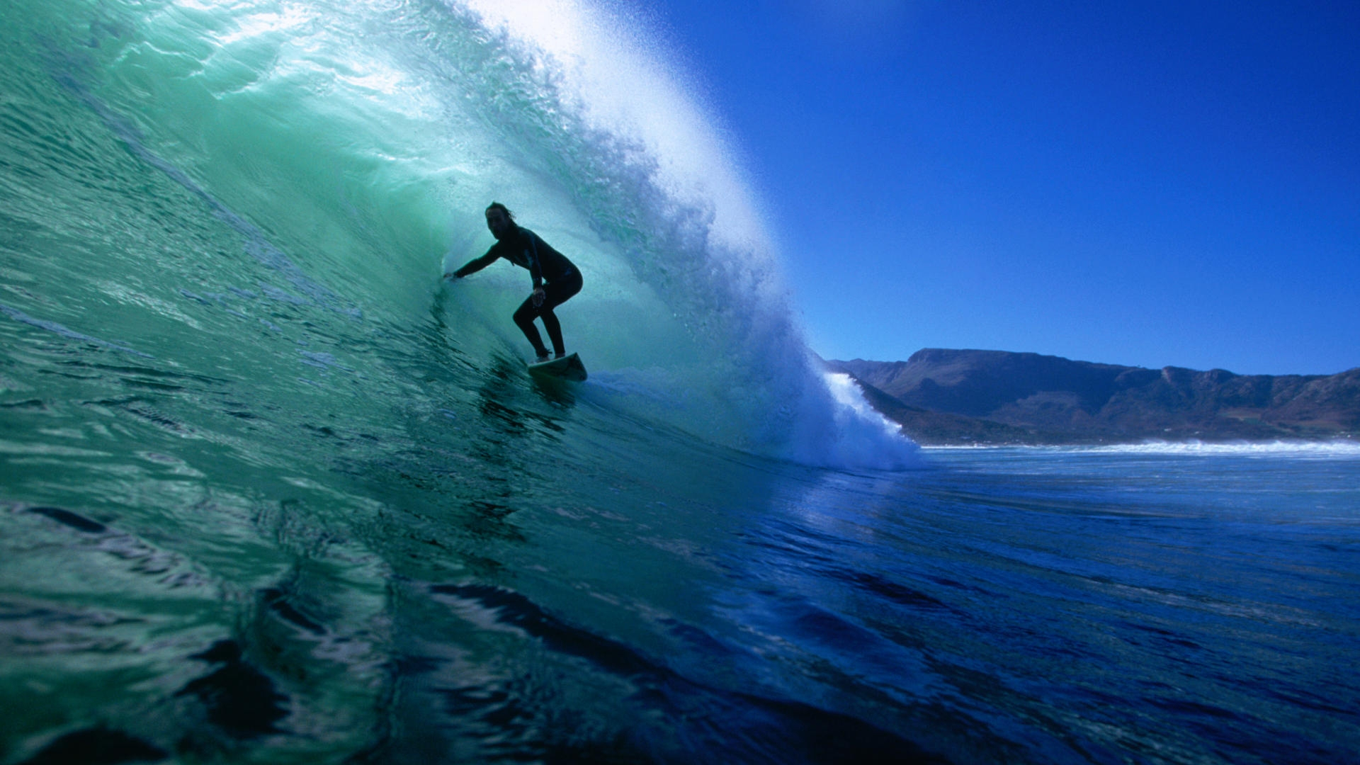 Surfer photo wallpaper on the crest of a wave