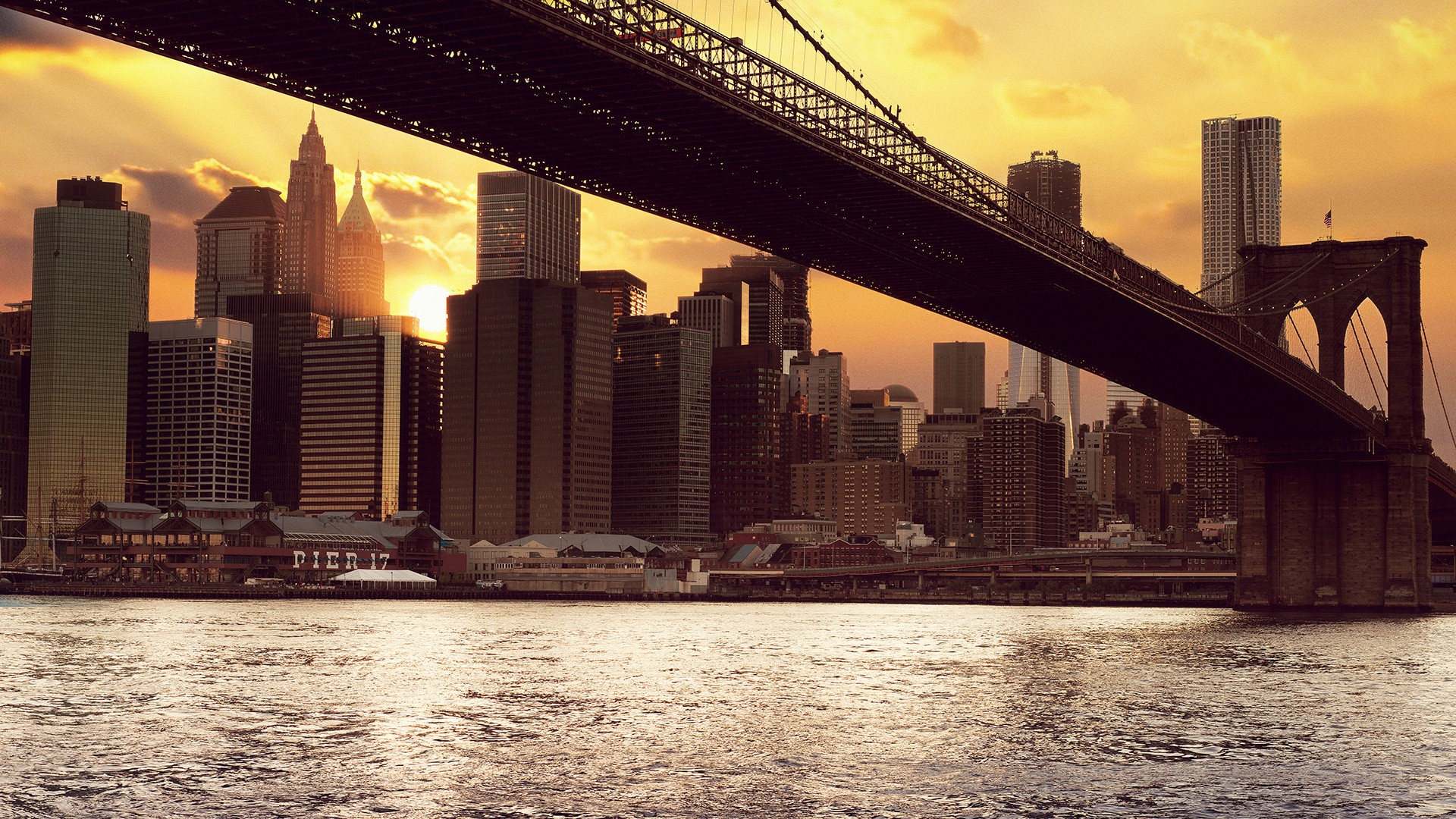 A beautiful view of New York from under the bridge