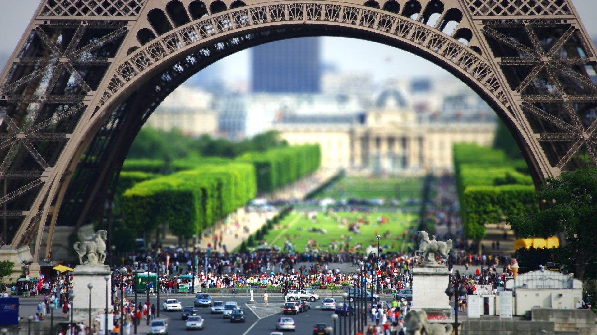 Tilt shift photo at the foot of the Eiffel Tower
